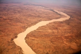 A dried up river filled with sand winds its way across the desert near Gos Beida in eastern Chad, June 5, 2008.