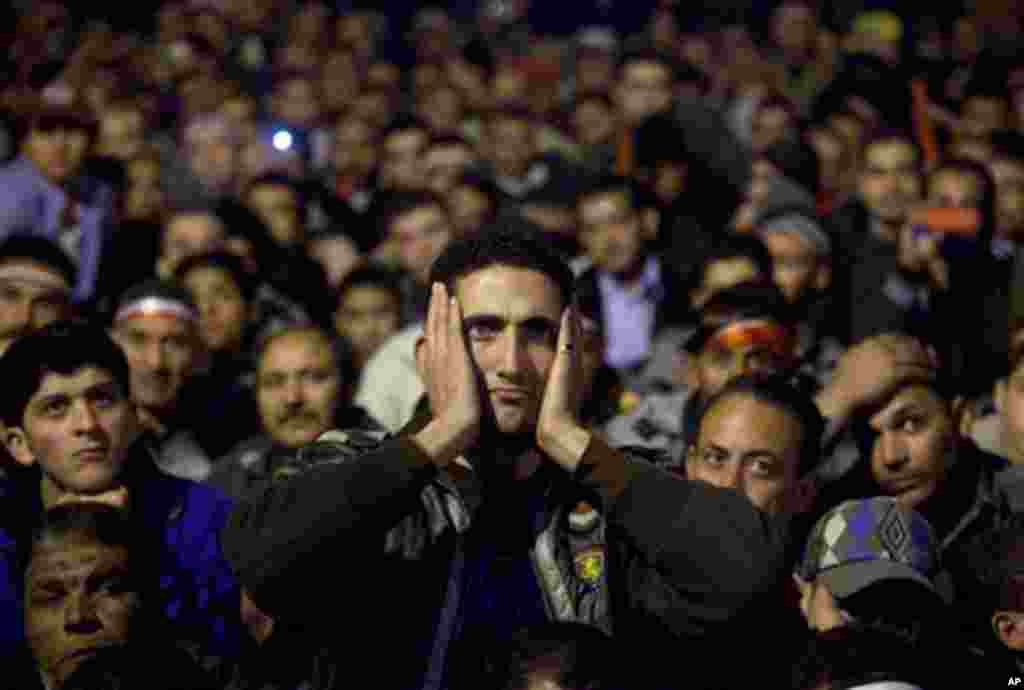 Anti-government protesters watch on a big screen as Egyptian President Mubarak makes a televised statement to his nation in Tahrir Square in downtown Cairo, Egypt Thursday, Feb. 10. (AP Photo/Emilio Morenatti)