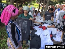 T-shirts printed with Cambodia's Cham alphabets are for sale. According to community members, Cham language and script learning has declined due in part to a lack of its inclusion in formal school curriculum in Cambodia. (Courtesy photo of Leb Ke)