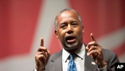 Republican presidential candidate Ben Carson speaks during the Rising Tide Summit in Cedar Rapids, Iowa, Dec. 5, 2015. Carson canceled a trip planned for later this month to Africa due to what his campaign called significant security concerns.