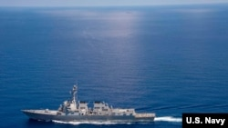 USS Lassen (DDG 82) operates in international waters near the Chinese People's Liberation Army (Navy) Jianghu V-class frigate Dongguan (560) while on patrol in U.S. 7th Fleet. #AroundtheFleet — at South China Sea.