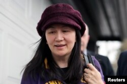 FILE - Huawei Technologies Co Chief Financial Officer Meng Wanzhou arrives back at home after her court appearance in Vancouver, British Columbia, Canada, March 6, 2019.
