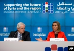 European Union foreign policy chief Federica Mogherini, right, and U.N. Office for the Coordination of Humanitarian Affairs Greg O'Brien, left, address a media conference at an EU Syria conference at the Europa building in Brussels, Belgium, April 5, 2017.