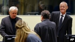 Jovica Stanisic, left, and Franko Simatovic, right, appear in court for their retrial at the United Nations Mechanism for International Criminal Tribunals in The Hague, Netherlands, June 13, 2017.