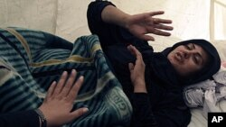 Afghan Lawmaker from western Herat province, Simeen Barakzai, discusses her issues as she continued her fast for the eight consecutive day in Kabul, Afghanistan, October 9, 2011.