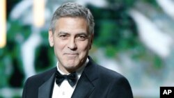 George Clooney speaks on stage prior to receiving an Honorary Cesar award during the ceremony of 42nd Cesar Film Awards, at the Salle Pleyel, in Paris, France, Feb. 24, 2017.