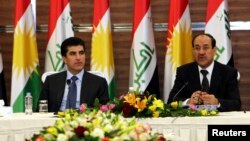 Iraqi Prime Minister Nuri al-Maliki (R) speaks next to his Iraqi Kurdish counterpart Nechirvan Barzani during a meeting of the Council of Ministers in Arbil, about 350 km (220 miles) north of Baghdad, June 9, 2013.