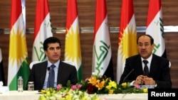 Irački premijer Nuri al Maliki i njegov kolega premijer iračkih Kurda, Neccirvan Barzani tokom sastanka u Arbilu, 9. juni, 2013.