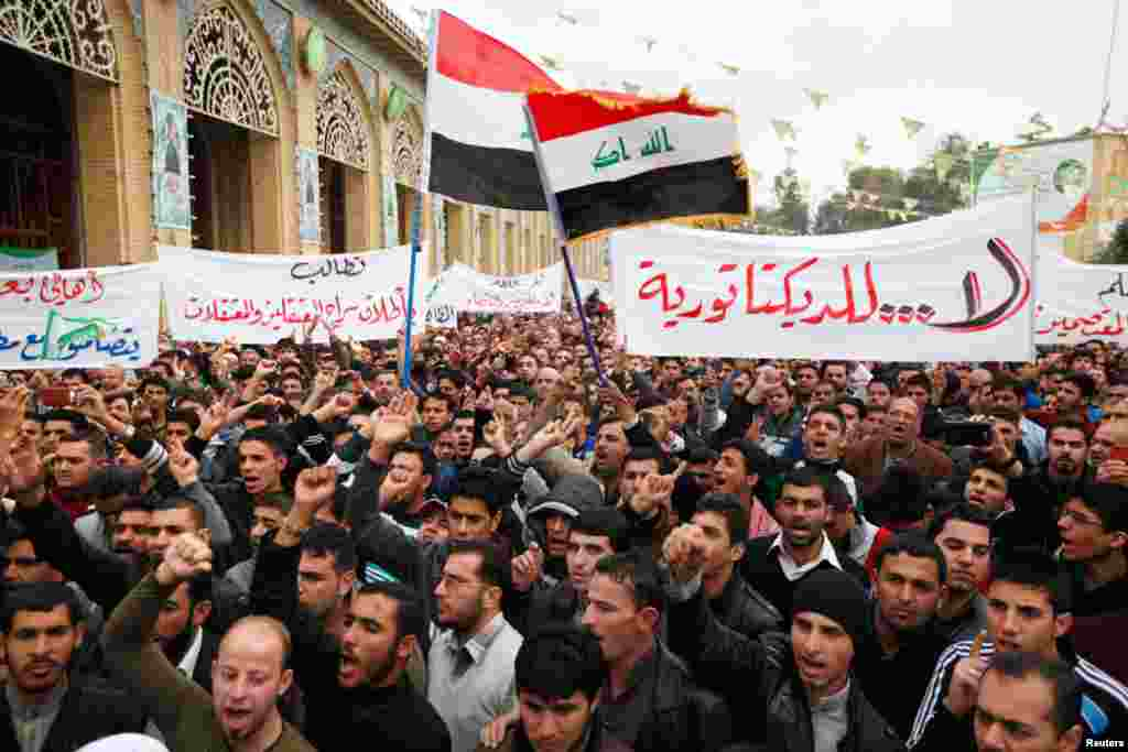 Iraqi Sunni Muslims take part in an anti-government demonstration at the Abu Hanifa Sunni mosque in Baghdad's Adhamiya district, January 25, 2013.