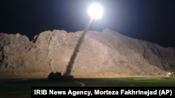 FILE - A missile is fired from city of Kermanshah, in western Iran, targeting the Islamic State group in Syria, June 19, 2017. Syrian government and allied troops have inserted themselves into the battle against IS militants by capturing key areas on the flanks of the coalition-led battle to seize Raqqa.