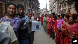Nepalese stand in line to vote at a polling station in Bhaktapur, Nepal, May 14, 2017. Nepalese lined up to vote Sunday for representatives in municipality and village council positions held in the Himalayan nation for the first time in two decades.