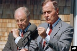 FILE - Then-Defense Secretary Dick Cheney and then-President George H.W. Bush, pictured in 1990.
