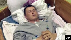 俄罗斯特种部队中士Sgt. Alexander Alexandrov2015年5月18日在乌克兰首都一家医院病床上