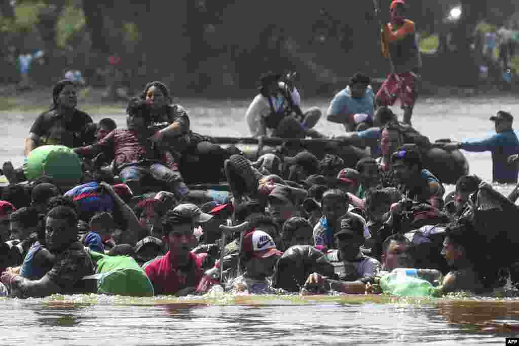 Migrants cross the Suchiate River from Tecun Uman in Guatemala to Ciudad Hidalgo in Mexico, after a security fence on the international bridge was reinforced,