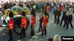 FILE - Guardsmen escort the coffin of Diana, Princess of Wales draped in the Royal Standard, as the cortege passes through crowds gathered along Whitehall. Walking behind them are the Duke of Edinburgh, Prince William, the Earl of Spencer, Prince Harry and Princ