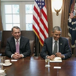 President Barack Obama sits with House Speaker John Boehner of Ohio (L), as he met with Republican and Democratic leaders regarding the debt ceiling, at the White House (File Photo - July 14, 2011)