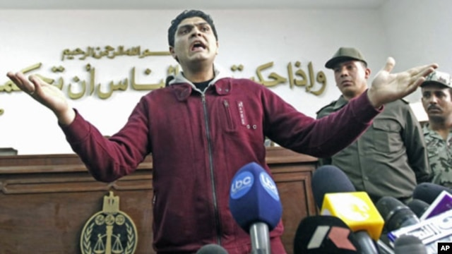 Army doctor Ahmed Adel, who was accused of carrying out a forced virginity test on a female detainee, speaks to the media after being acquitted, in Cairo, Egypt, March 11, 2012.