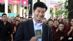 Lobsang Sengey, shows his green book as he arrives to cast his vote in Dharmsala, India (File Photo - March 20, 2011)