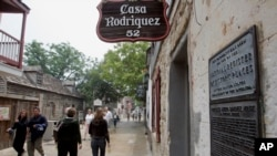 Visitors walk past the Casa Rodriguez, one of the oldest structures in St. Augustine.