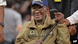 FILE - Richard Overton leaves the court after a special presentation honoring him as the oldest living American war veteran, March 23, 2017, at an NBA basketball game.