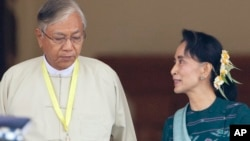 Htin Kyaw, left, newly elected president of Myanmar, walks with National League for Democracy leader Aung San Suu Kyi at Myanmar's parliament in Naypyitaw, Myanmar. (AP Photo/Aung Shine Oo)