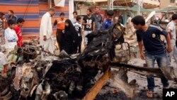 Один из взорванных автомобилей, Ирак, Багдад, 20 мая 2013г.