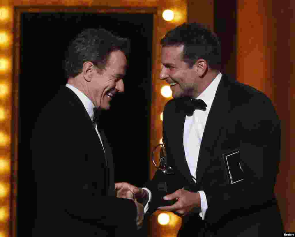 "Bradley Cooper (right) presents Bryan Cranston with the Award for Best Performance by an Actor in a Leading Role in a Play for ""All The Way"" during the American Theatre Wing's 68th annual Tony Awards at Radio City Music Hall in New York, June 8, 2014."
