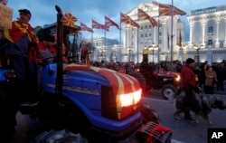Farmers on tractors participate in a protest in front of the government building in Skopje, Macedonia, March 10, 2017. Thousands of ethnic Macedonians have held evening protests against three ethnic Albanian parties forming a coalition government with the Social Democrats.