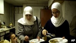 A Muslim family end their day of fasting with a meal at a mosque in Cedar Rapids, Iowa