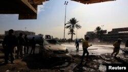 巴格达一处汽车炸弹袭击现场(2014年1月15日)