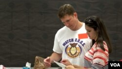 Adam Mehmud is a volunteer at his son's school through the Watch D.O.G.S. group.