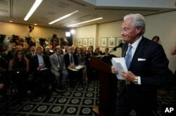 Marc Kasowitz personal attorney of President Donald Trump, leaves a packed room at the National Press Club in Washington, June 8, 2017 after delivering a statement following the congressional testimony of former FBI Director James Comey.