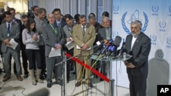 Iran's International Atomic Energy Agency ambassador Ali Asghar Soltanieh (R) briefs the media during a board of governors meeting at the United Nations headquarters in Vienna, Austria, March 8, 2012.