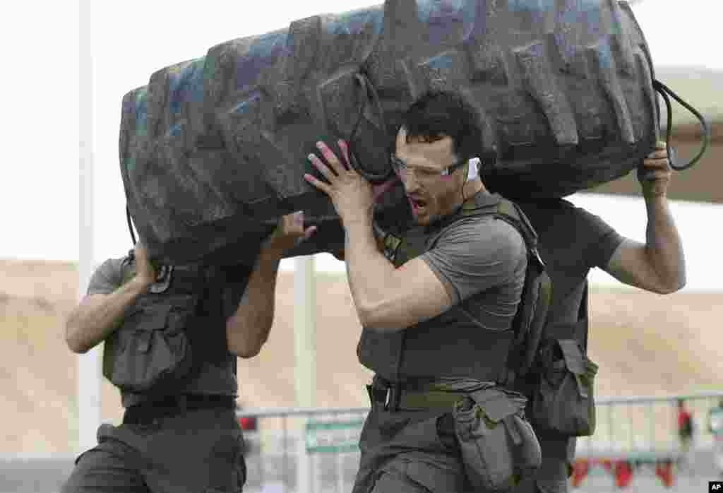 EKO Cobra, a police tactical unit from Austria, competes during the UAE SWAT Challenge, organized by the United Arab Emirates interior ministry in Dubai, UAE.