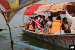 Congress party General Secretary and eastern Uttar Pradesh state in-charge Priyanka Gandhi Vadra, center, takes a boat ride to the Sangam, the confluence of sacred rivers the Yamuna, the Ganges and the mythical Saraswati, in Prayagraj, India, March 18, 2019.