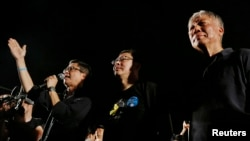 FILE - Founders of the Occupy Central civil disobedience movement, from left, Chan Kin-man, Benny Tai and Chu Yiu-ming, attend a campaign to kick off the movement in Hong Kong, Aug. 31, 2014.
