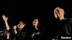 占中发起人陈健民、戴耀廷和朱耀明在8月31号运动开始时的誓师会上