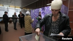 People vote at a polling station during previous parliamentary elections. (FILE)