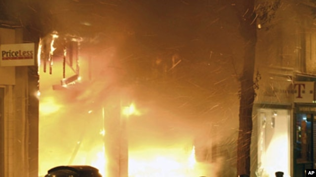 Store blazes fiercely during looting in the Woolwich district of southeast London August 9, 2011