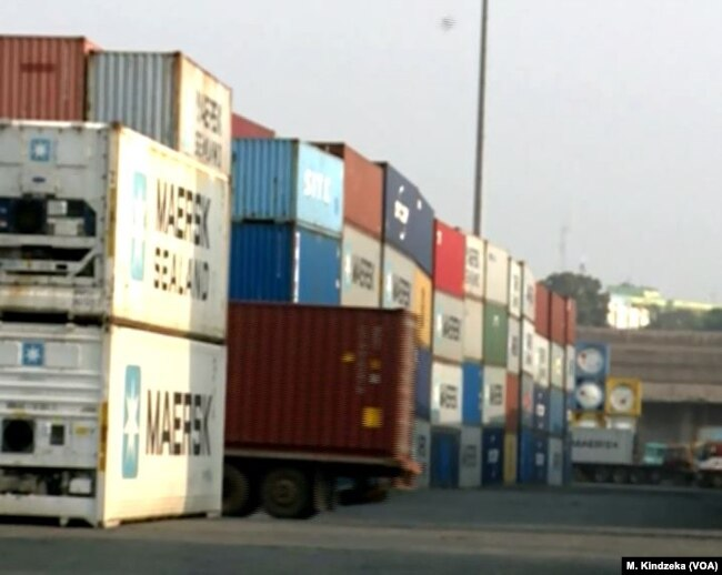 Shipping containers are stacked up, Jan. 10, 2019, at the port of Douala, Cameroon.