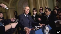 Senate Majority Leader Sen. Harry Reid, D- Nev., talks to the media after a Democratic policy luncheon on in Washington, March 1, 2011
