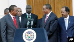 Kenya's President Uhuru Kenyatta, left, Ethiopian Prime Minister, Hailemariam Desalegn, middle right, and Somalian President, Hassan Sheikh Mohamud, right, after the IGAD meeting.