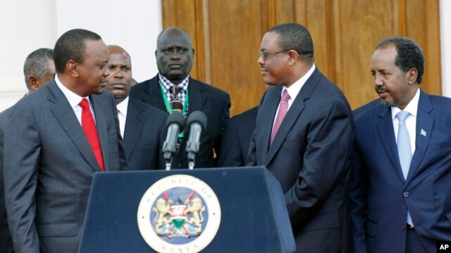 FILE - Kenya's President Uhuru Kenyatta, left,  Ethiopian Prime Minister, Hailemariam Desalegn, middle right, and Somalian President, Hassan Sheikh Mohamud, right, after the meeting of the Intergovernmental Authority on Development (IGAD) consultative meeting on the situation on South Sudan, held at State House, Nairobi, Kenya.