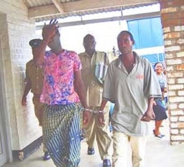 Tiwonge Chimbalanga and Steven Monjeza are taken into custody after celebrating their engagement
