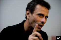 FILE - Venezuela's opposition leader Henrique Capriles speaks during an interview at his office in Caracas, Venezuela, July 30, 2018.