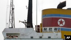 FILE - North Korean sailors stand on the deck of the North Korean-flagged cargo ship Chong Chon Gang in Sherman Bay near Colon City, Panama, February 12, 2014.