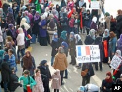 At a woman's rally in Benghazi, Libya, supporters show their appreciation that France has recognized the Transitional Council as the legitimate representative of the Libyan people, March 10, 2011