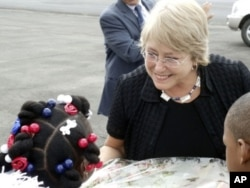 Michelle Bachelet is greeted by young children at Monrovia's Roberts International Airport on her first visit to Liberia in her new position.
