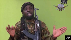 FILE - A photo taken from a video by Nigeria's Boko Haram militant group in May 2014 shows their leader Abubakar Shekau speaking to a camera.