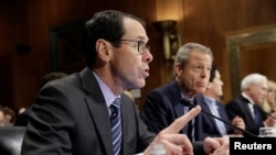 CEO of AT&T Randall Stephenson (L) speaks as Chairman and CEO of Time Warner Jeffrey Bewkes listens during testimony before the Senate Judiciary Committee Antitrust Subcommittee hearing on the proposed deal between AT&T and Time Warner in Washington, Dec. 7, 2016.